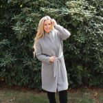 Girl wearing gray wool belted Amazon coat